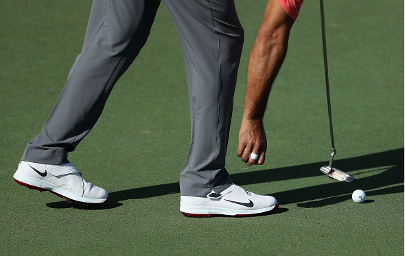 Tiger Woods Laces Up His New Nike TW