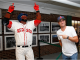 Justin Thomas poses with a statue of David Ortiz
