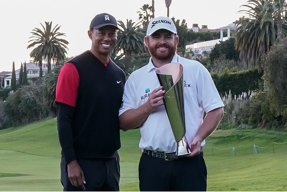 Tiger Woods and J.B. Holmes
