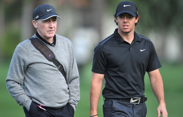 Rory McIlroy talks with his coach Michael Bannon