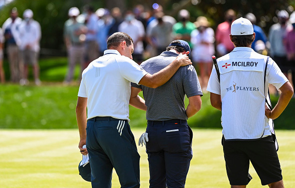 Sergio Garcia puts his arm around Rory McIlroy