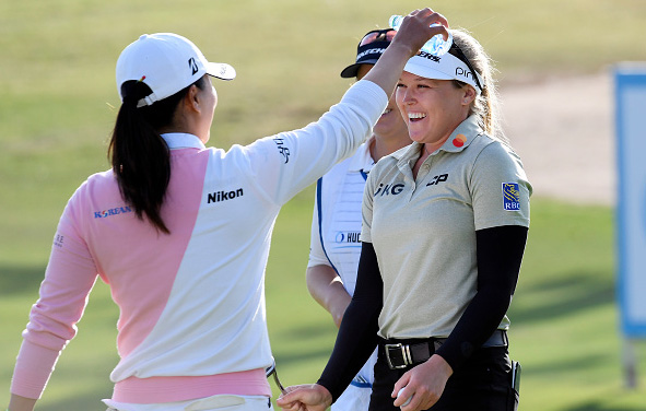 Brooke Henderson is doused with water by Jin Young Ko
