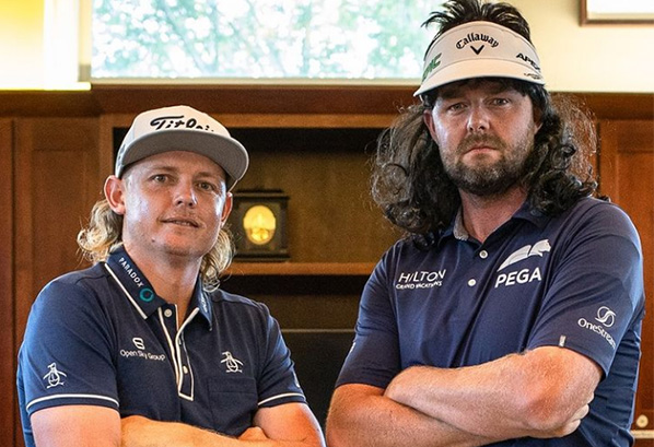 Marc Leishman, wearing a wig mullet, and Cameron Smith