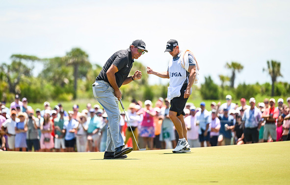 Phil Mickelson and caddie Tim Mickelson
